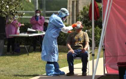 德克薩斯州周六報告新冠病毒感染率單日最高