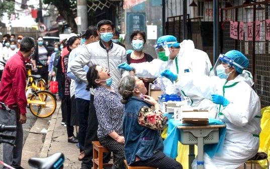 中国新人群中的冠状病毒患者表现出与武汉患者不同的症状