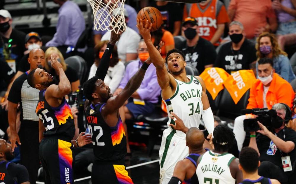 雄鹿多点开花险胜太阳贏得赛点    再胜一战NBA称王